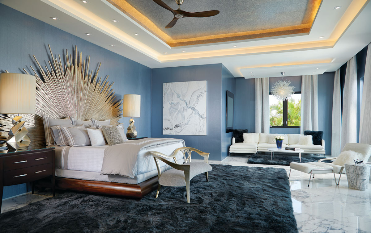 In calming shades of blue, the master bedroom features an oak platform bed from Christopher Guy with a spectacular silver-leaf sunburst headboard. A sumptuous hand-carved loveseat sits in perfect complement at the foot of the bed.