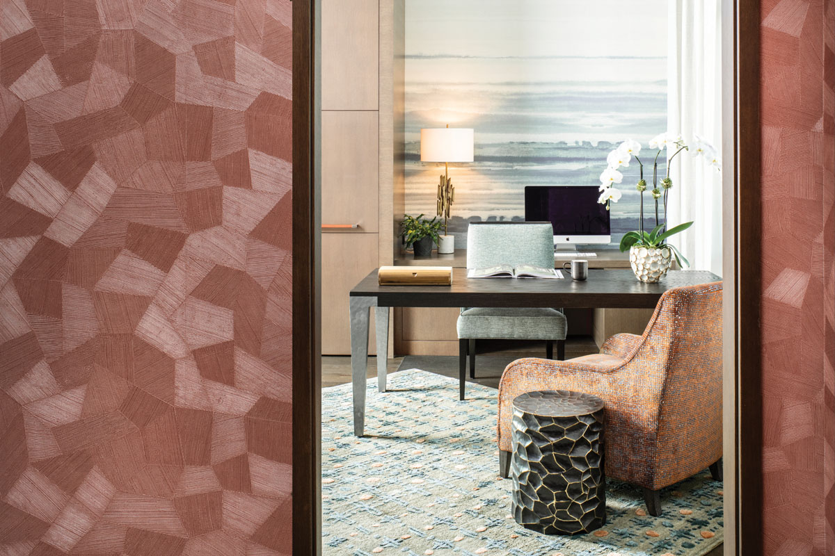 Anchored by a Robert James desk, the study reads as expansive thanks to the Phillip Jeffries' mural on the far wall. Bernhardt's lounge chair casually sits on a Niba area rug.
