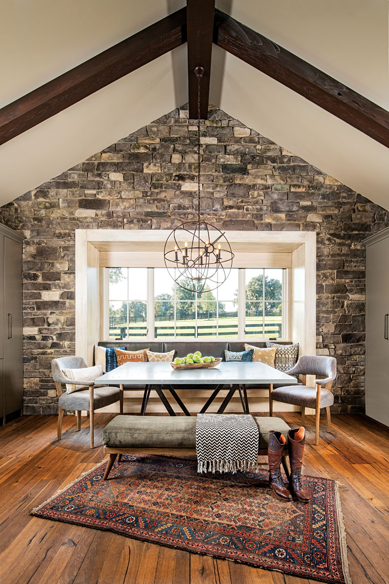 The barn's breakfast area exemplifies how the quintessentially traditional bones of this home, both the interior and exterior, are in harmony with the landscape and the modern elements it comfortably embraces.