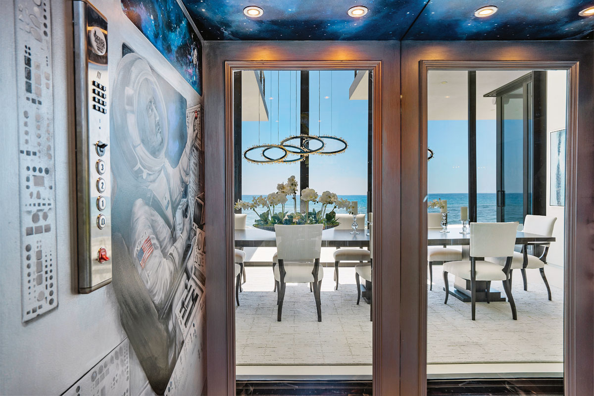 For fun, a glass-fronted elevator with an ocean view through the dining room, celebrates the 50th anniversary of the historic Apollo 11 moon landing, complete with a constellation of stars that envelops Frank McKinney suited up as an astronaut.