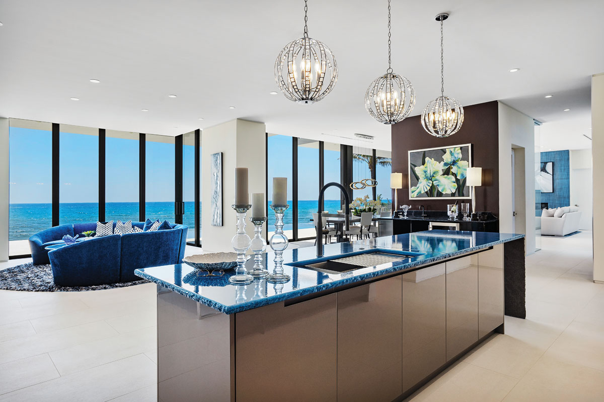Glazed and fired, slabs of 11,000-year-old natural lava top the kitchen island in a fiery blue. Chrystorama pendants from Capitol Lighting shimmer above the island, while counter stools from Hooker tuck neatly beneath to avoid obstructing the view of the Atlantic Ocean.