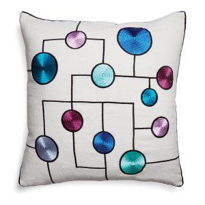 """Jewel-toned circles style the shimmering """"Global Trellis"""" pillow by jonathan adler. jonathanadler.com"""
