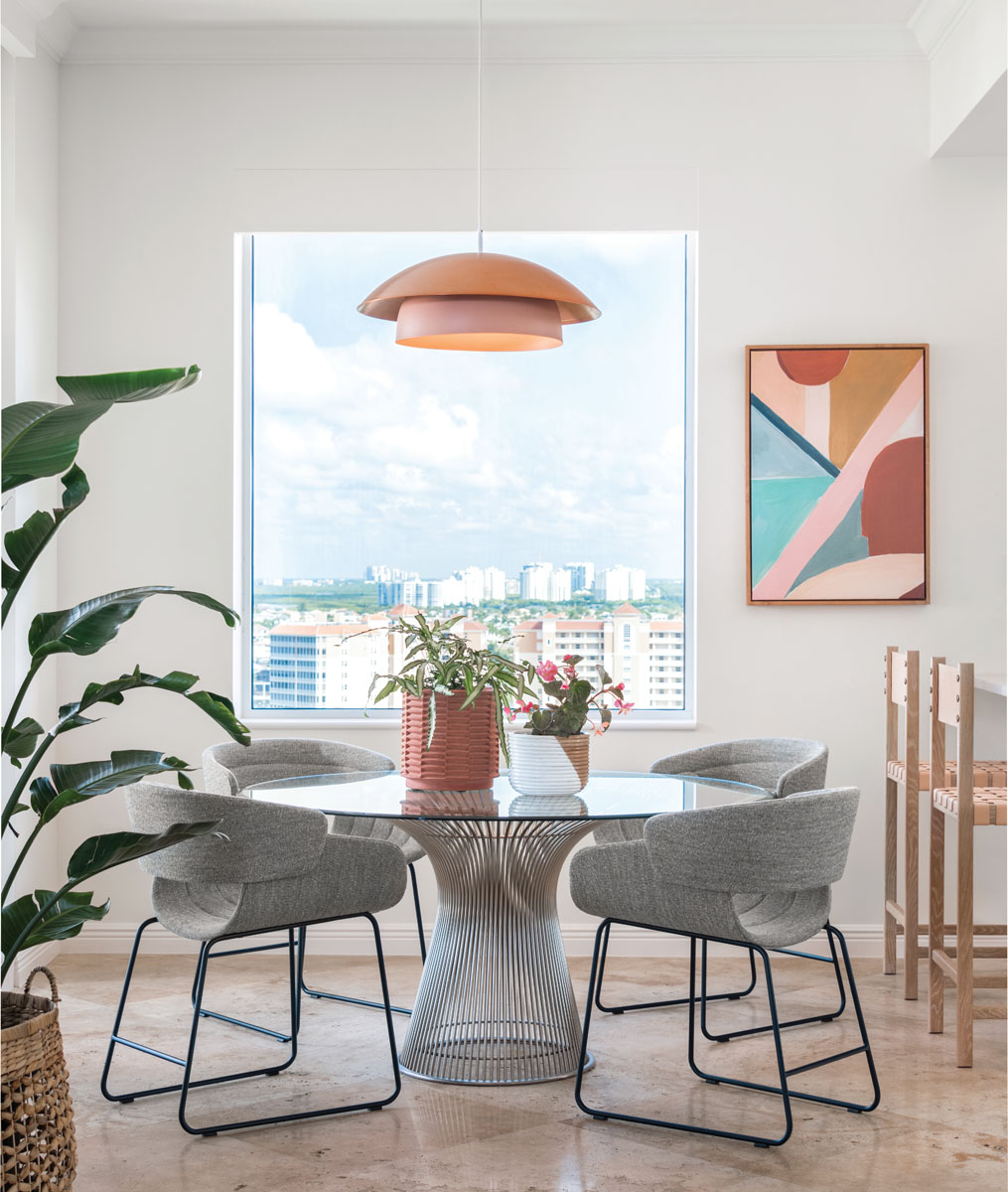 Picture-perfect, the breakfast nook captivates with Luminaire's whimsical pendant light that center's the space above Warren Platner's classic steel-based table with its fun and quirky take on casual dining.