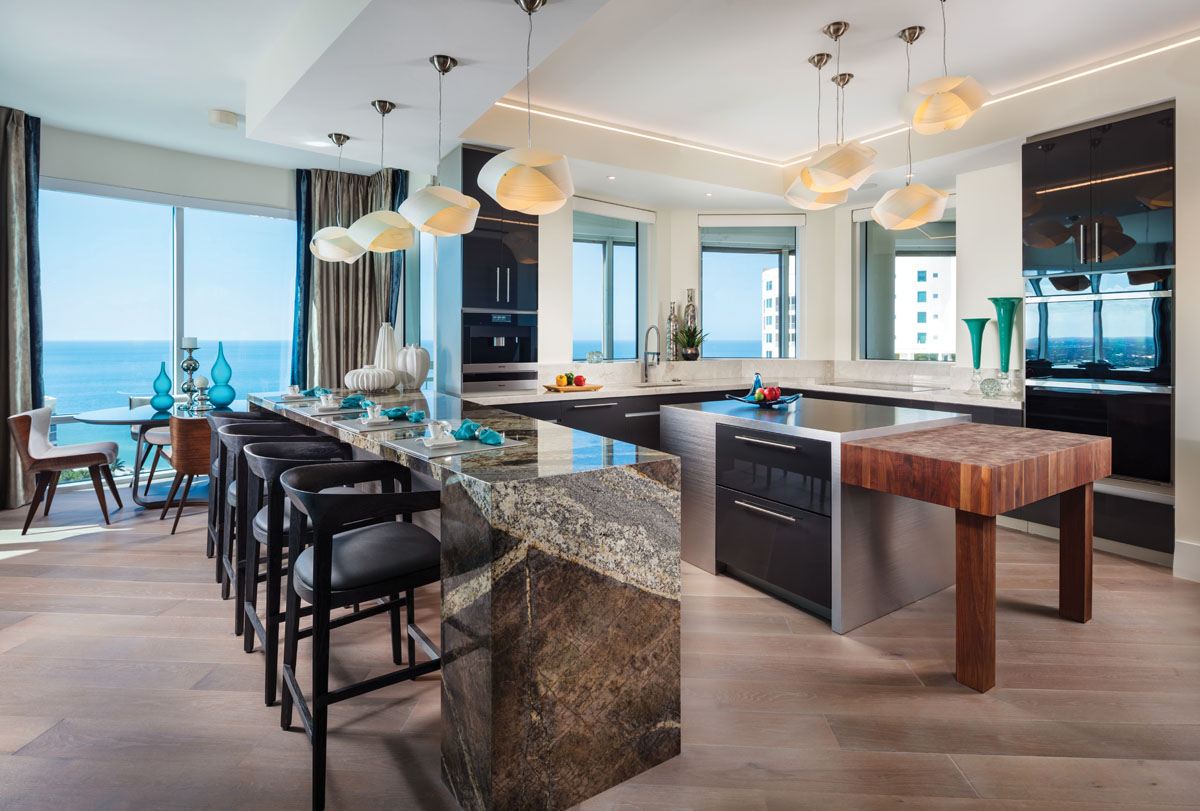 In this sleek multi-functional kitchen, quartzite and granite from UMI Naples complement the espresso-stained, mirror-lacquered cabinetry by Harden House. The island is utility friendly with both stainless steel and butcher-block surfaces that ensure professional-level gourmet adventures.