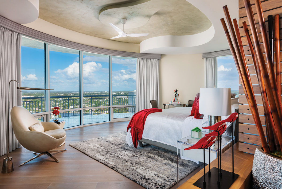 In the master bedroom, incredible views circle across the Gulf and out toward the distant Everglades. Once again, O'Guin Decorative Finishes brings the outside in with a wavy, ceiling treatment that appears to float above a platform bed from Huppé. The teak slats of a feature wall lend a fitting reverence to yachting.