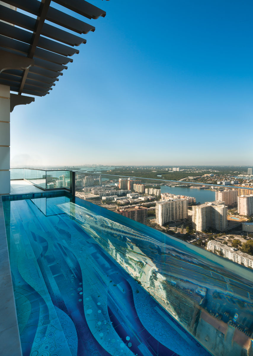 """The pool with its transparent acrylic bottom provides a surreal experience,"" interior designer Isabel Tragash says. ""Swimmers can look out to the Intracoastal Waterway or up at the exquisite hanging garden we installed on the east side of the terrace."""
