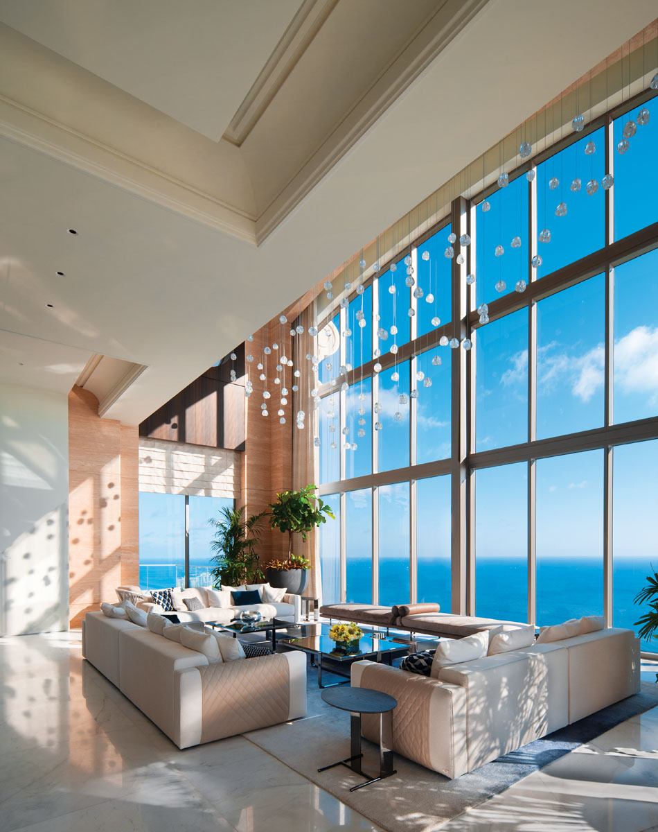 With a view from the living area, aircraft flying below the home are often seen because the penthouse is situated higher than many helicopters and small private planes fly. When it is clear and bright, sharks and people can be seen swimming in the ocean below.