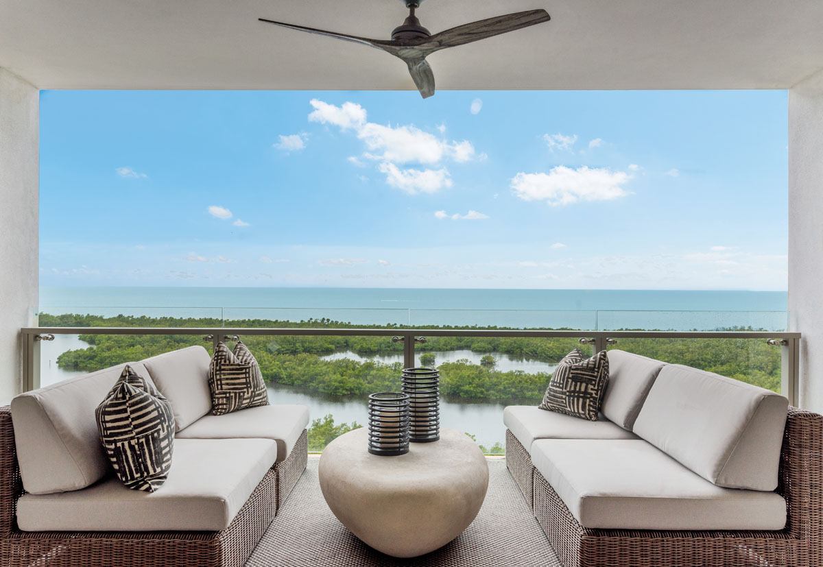 Outside, ocean views swarm the senses. It's what the balcony celebrates with an intimate grouping styled with a pair of Kingsley Bate sofas and Phillips Collection's cocktail table reminiscent of a worn river rock. Surya's area rug exudes luxury while encouraging barefoot relaxation.