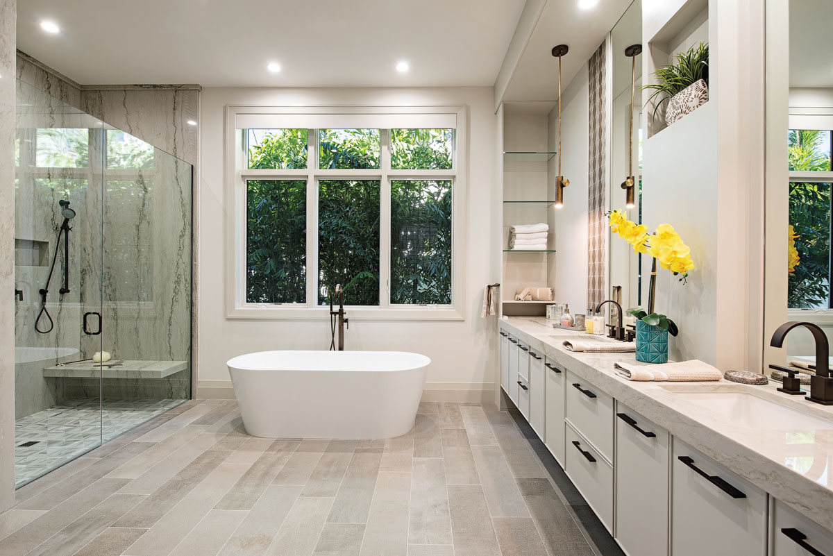 The master bath is one of the rooms that inspires the homeowners to declare that the home is a calming retreat. The freestanding tub from Fergusson and the spa-like shower will see ample use when bicycle rides and walks on the beach are over.
