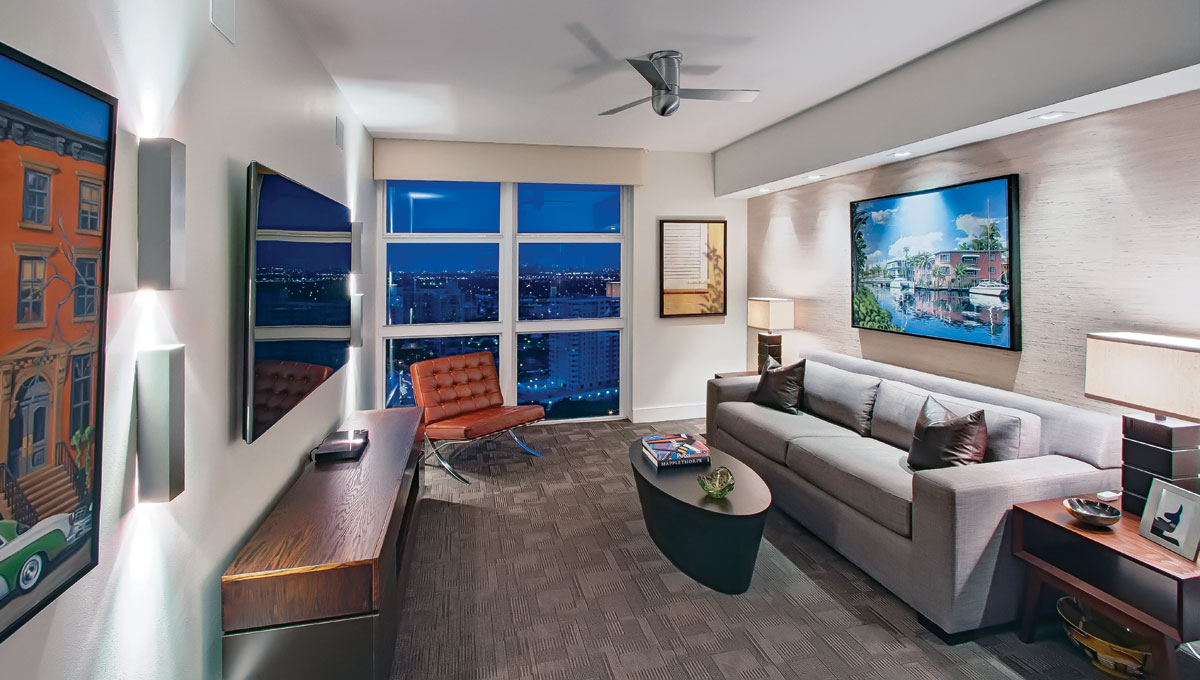 The office converts to a guest room, where chocolate-brown leather pillows from Donghia outfit a sofa bed from Lazar in a linen-blend. On the wall above the sofa, Las Olas Isles, a piece by Bennett's friend Tim Balboni, adds seaside interest.