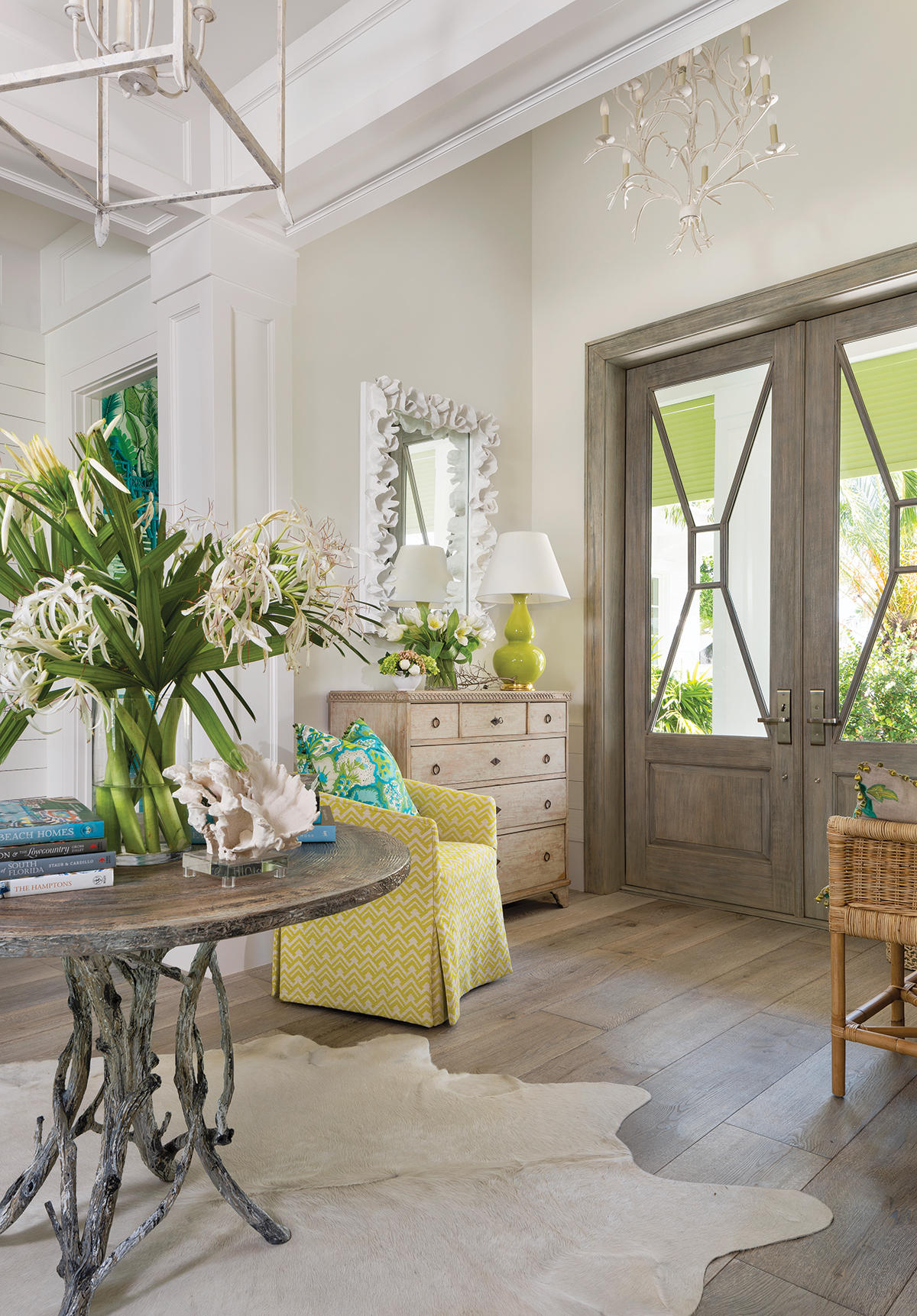 """The entry and the rest of the home is created with a mixture of antiques and new pieces, as well as some reproductions and modern pieces. So, you really have an eclectic mix like you would have in a cottage — only with a Palm Beach feel,"" interior designer Bethany O'Neil says. ""It's very warm and friendly."""
