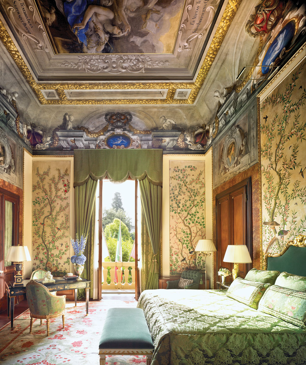 The Noble Suite offers magnificent views of the hotel's landscape. The frescoed vaulted ceiling in the bedroom and the breathtaking paneled and gold decorated ceiling in the living room, lend this suite an authentic Renaissance feel with modern day comforts. Photography by Barbara Kraft.