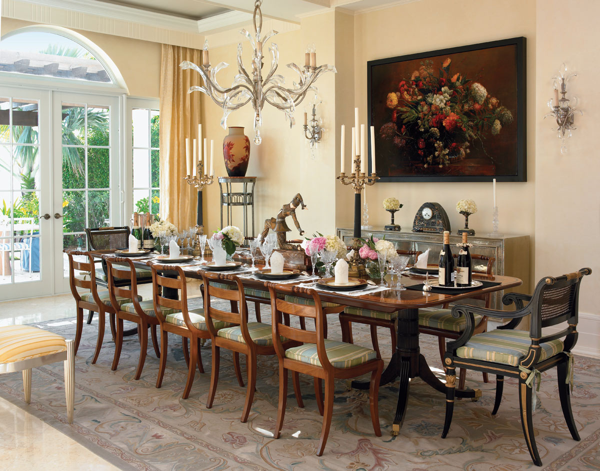 A painting by david bierk from nancy hoffman gallery provides a focal point in the dining room, where an original work by Romanian art deco sculptor Demetri Chiparus poses as a centerpiece of the baker table.
