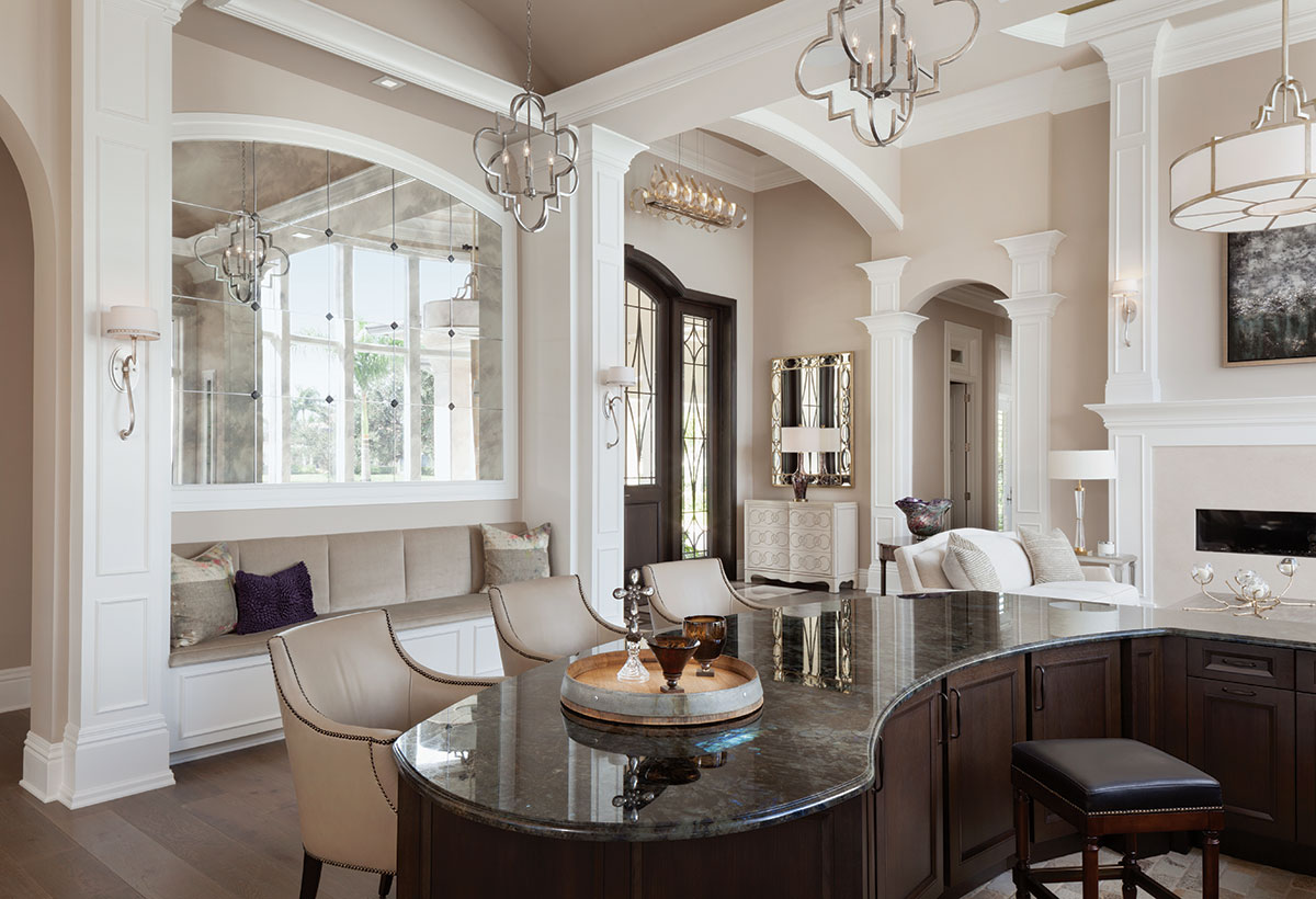 The home was configured for the couple's entertaining lifestyle. Upon entry, the bar area becomes an instant social center as Capital Lighting's fixtures cast a soft glow over Century Furniture's club chairs and a custom-designed banquette that provides ample seating for guests.