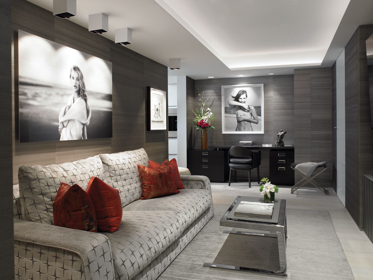 In the den, black and white photographs dominate, including The World is Your Oyster by Marc Lagrange above the Trussardi sofa by Luxury Living; and Lilla, Turtle Cove, NY by Michael Dweck above the desk. Phillip Jeffries' textural wall covering is a warm element, while Craven's design collaboration with Belt to handcraft a metal cocktail table that mechanically pops up to dining height is a cool one.