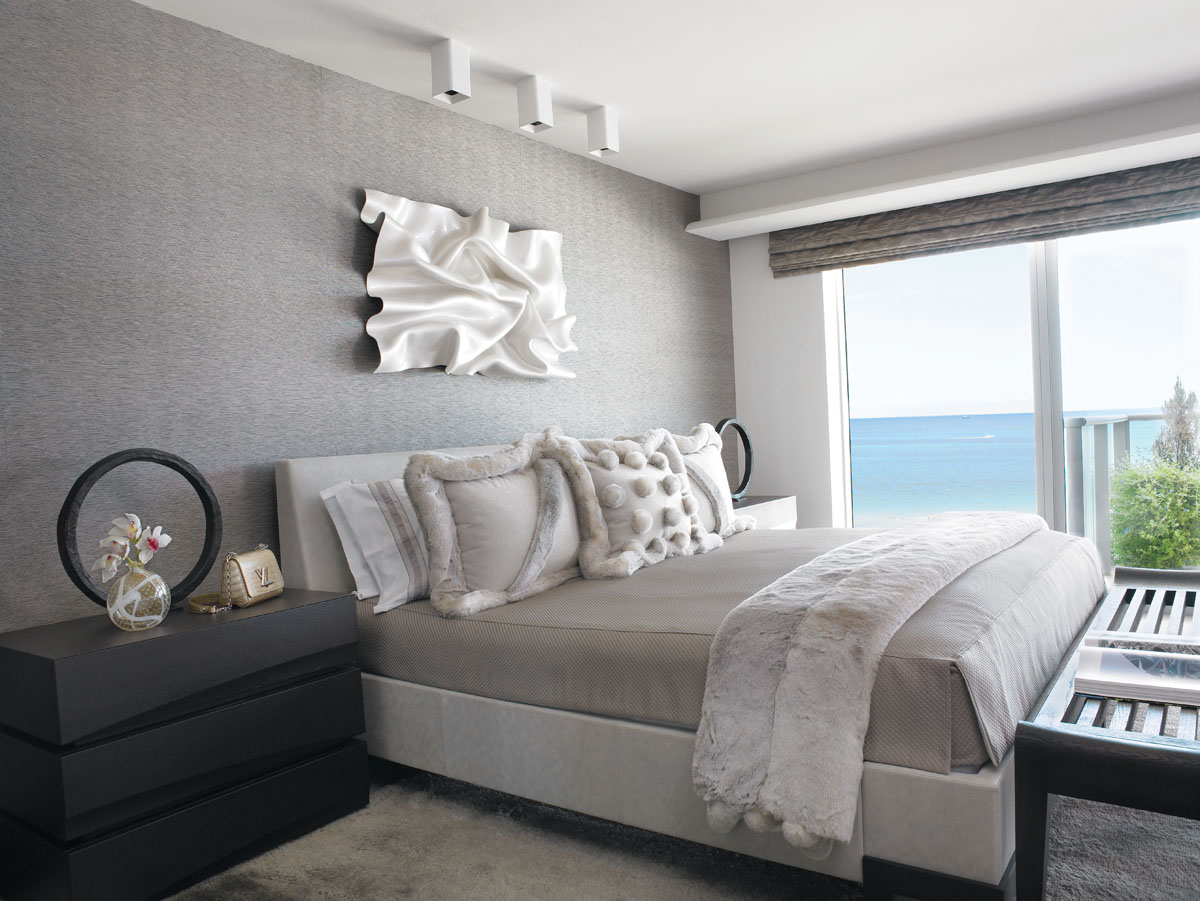 In the master bedroom, sculptor Paul Rousso's Flirtation from SmithDavidson Gallery aptly provides the artistic focal point above a Holly Hunt bed outfitted by Twill and Texture. Christian Liaigre circular lamps provide the unexpected atop bedside chests from David Sutherland.