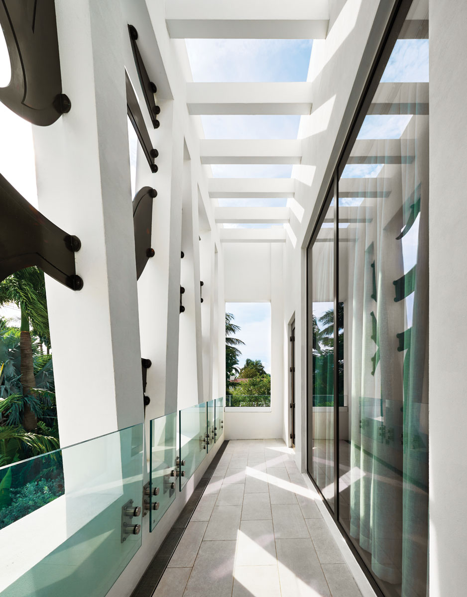 The second-floor porch adjacent to a guest bedroom links the interior to the home's uniquely artistic facade.