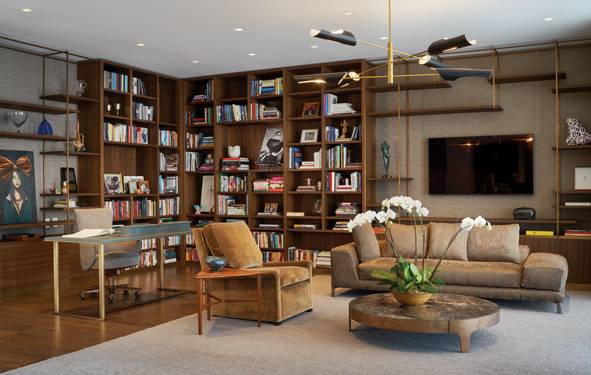 The open study doubles as a ground-floor sitting room furnished with minotti's sofa and a lounge chair from Dessin Fournir. Burnished by hand, Henge's steel and brass cocktail table pairs nicely with the vintage accent table from Adesso Eclectic Imports.