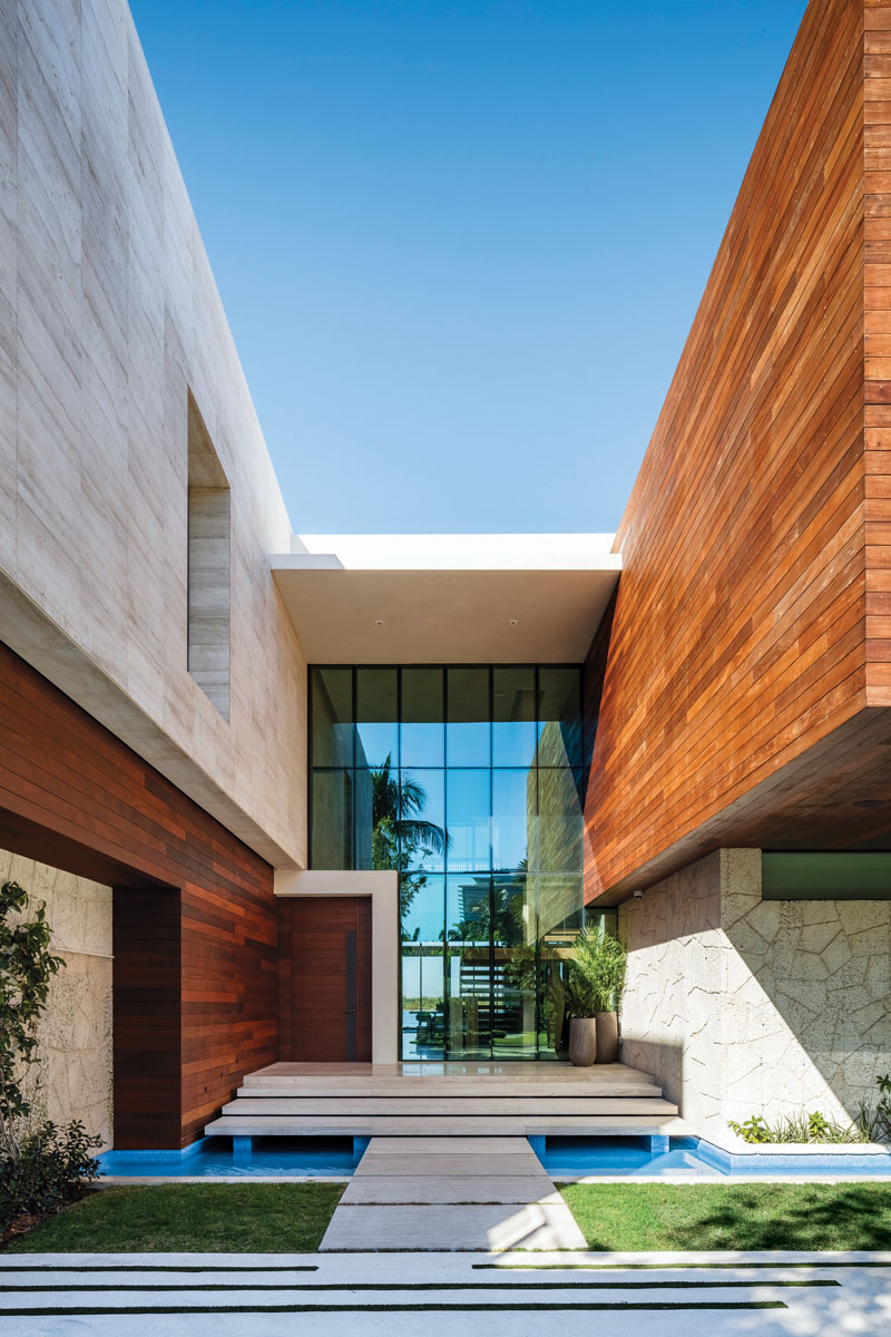 As if architect Ralph Choeff had created a case study in perspective, the home's exterior lines jut and thrust, play with shifting shadow, and demonstrate the masterful use of textures to create drama and intent. Softened by a reflecting pool, perhaps with a nod to feng shui, stone, wood and water are on full display.