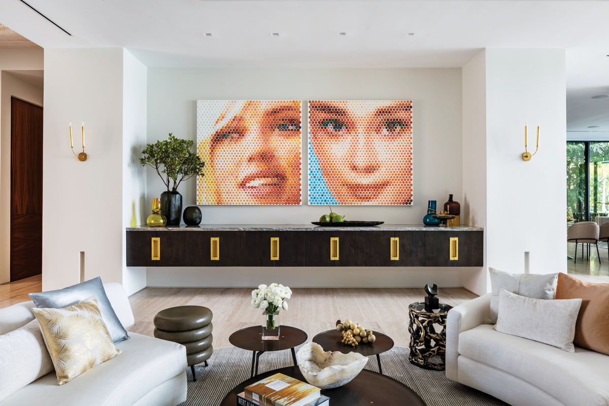 A jewel-like onyx slab becomes a panel to mirror art in the formal sitting room. Whether abstract or realistic, the choice of art defines who lives within. Playful actresses in oil by artist Gaven Rain seem delighted to have been welcomed in.