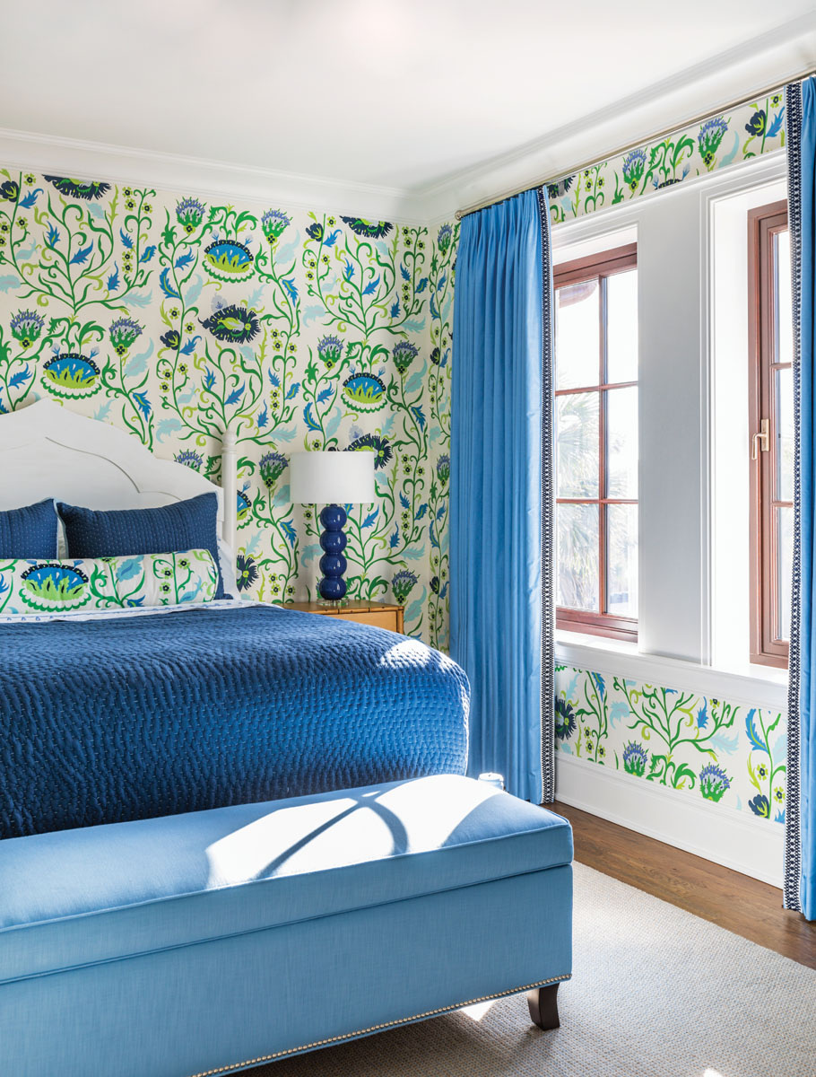 Beds from Redford House Furniture center the bedrooms wrapped in bold patterns of blues and greens. Whimsical prints and furniture make the upstairs children's rooms feel like a blissful vacation spot.