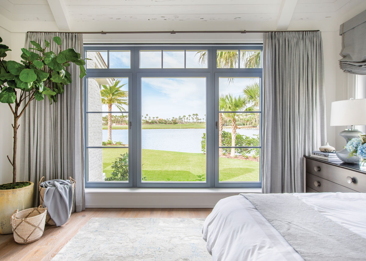 Serenity is the goal in the master bedroom, where soft-gray Belgian linen pulls open to frame golf course views, and Caravan's wool and silk area rug grounds the private space in a layer of texture.
