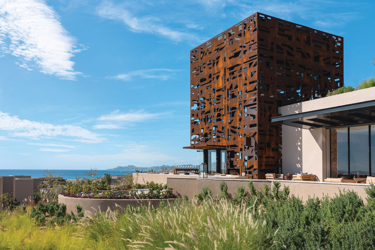 """A corten steel """"skin"""" encases the resort's agave bar, Candil. This cage-like structure creates an intimate mood inside the venue by filtering light and creating dramatic shadow play."""