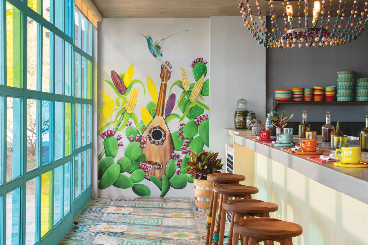 """El Barrio, the Mexicans' word for """"neighborhood,"""" features murals by local artists and traditional Mexican textiles. Executive chef Rodrigo Torres traveled throughout Mexico to source the colorful tableware."""