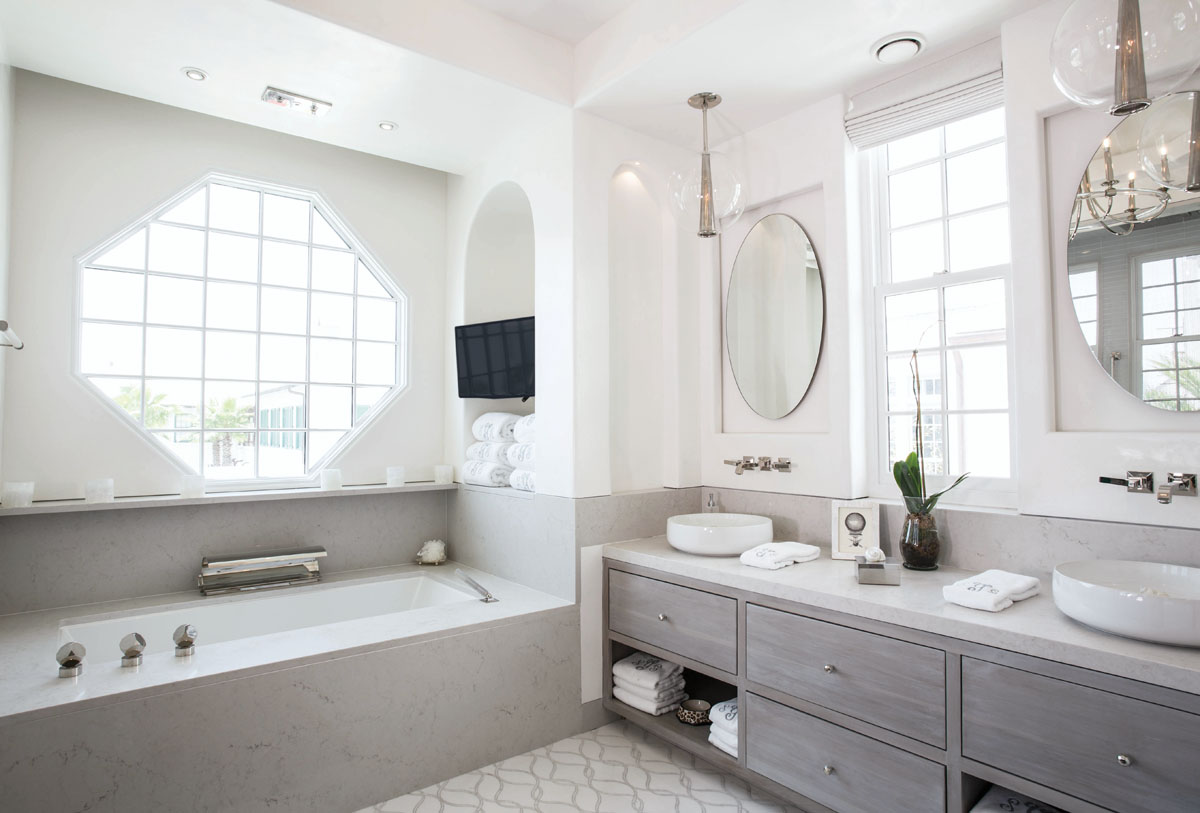 Nearby, the master bath features a dome ceiling, backlit recessed mirrors and inventive ways to fill the deep-soak tub.