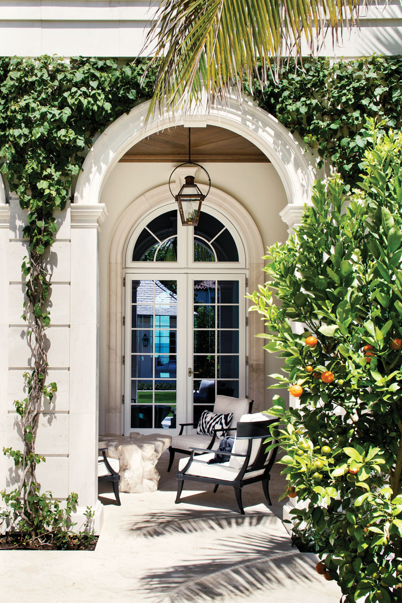 French doors open to welcome gentle ocean breezes as ivy climbs the hand-carved stonework that embraces the outdoor living spaces.