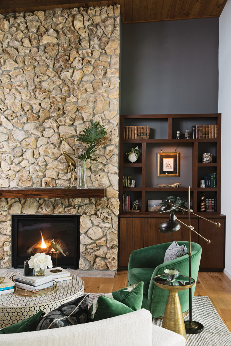 Florida fieldstone shapes the handlaid fireplace. Thayer Coggin barrel chairs swivel to catch a glimpse as a television rises from the custom media unit.
