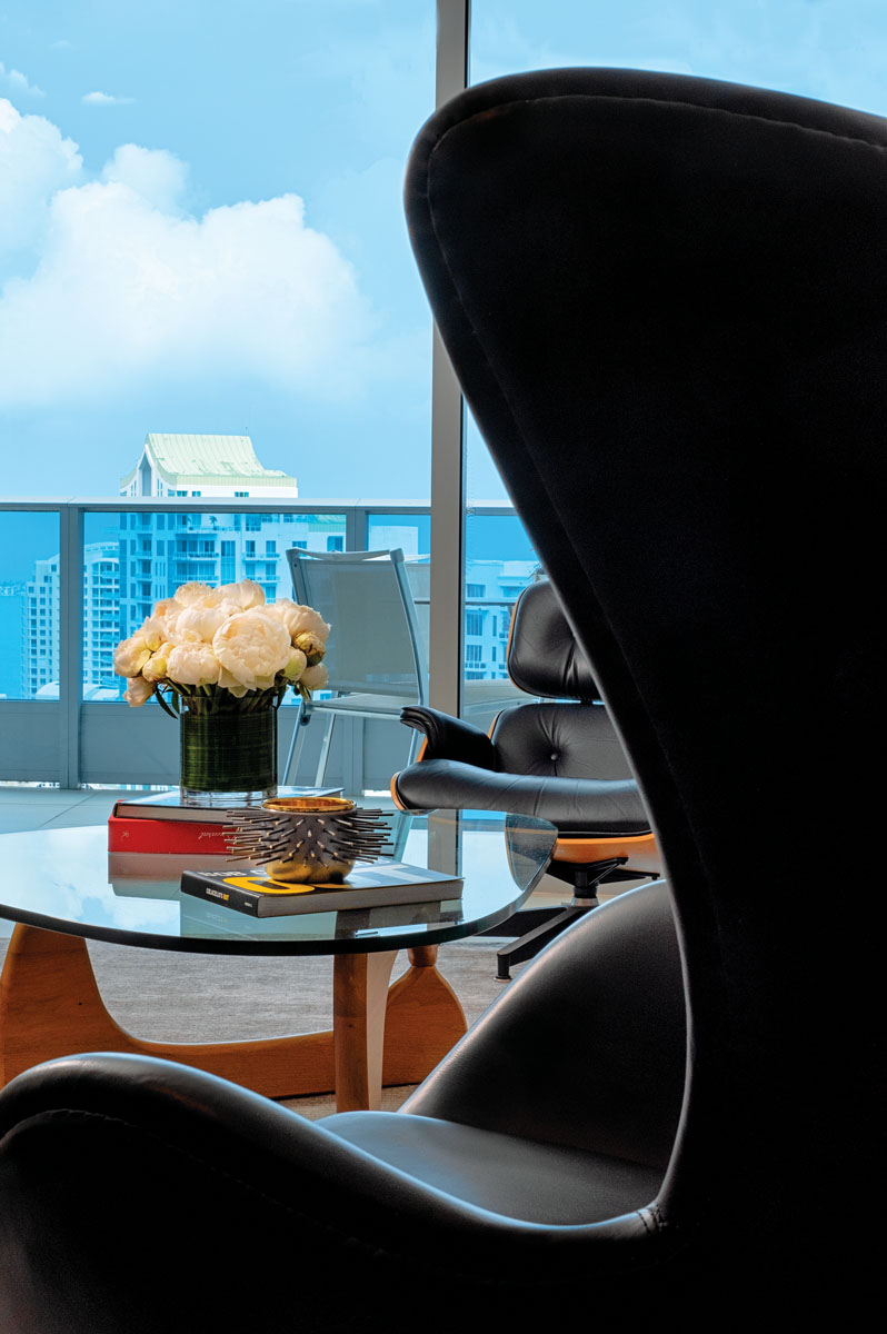 """""""Sexy yet comfortable, a black leather 'Egg Chair' designed by Arne Jacobson and the smaller, iconic Eames lounge chair add masculinity to a seating vignette that continues the vintage theme by honoring these wonderful designers,"""" Ruiz says."""