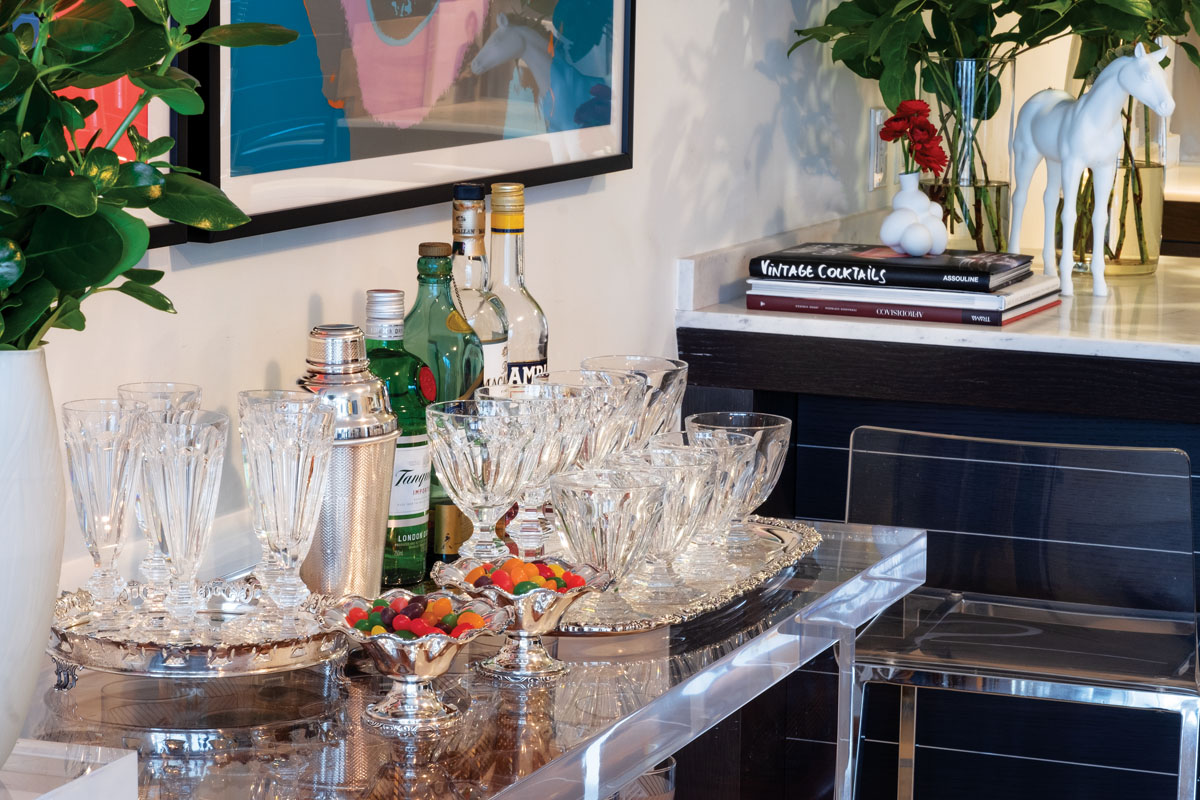 """Vintage crystal from Baccarat holds its own atop the bar as it dazzles in the evening light. """"I love the classic look of Baccarat,"""" the fashion designer says."""