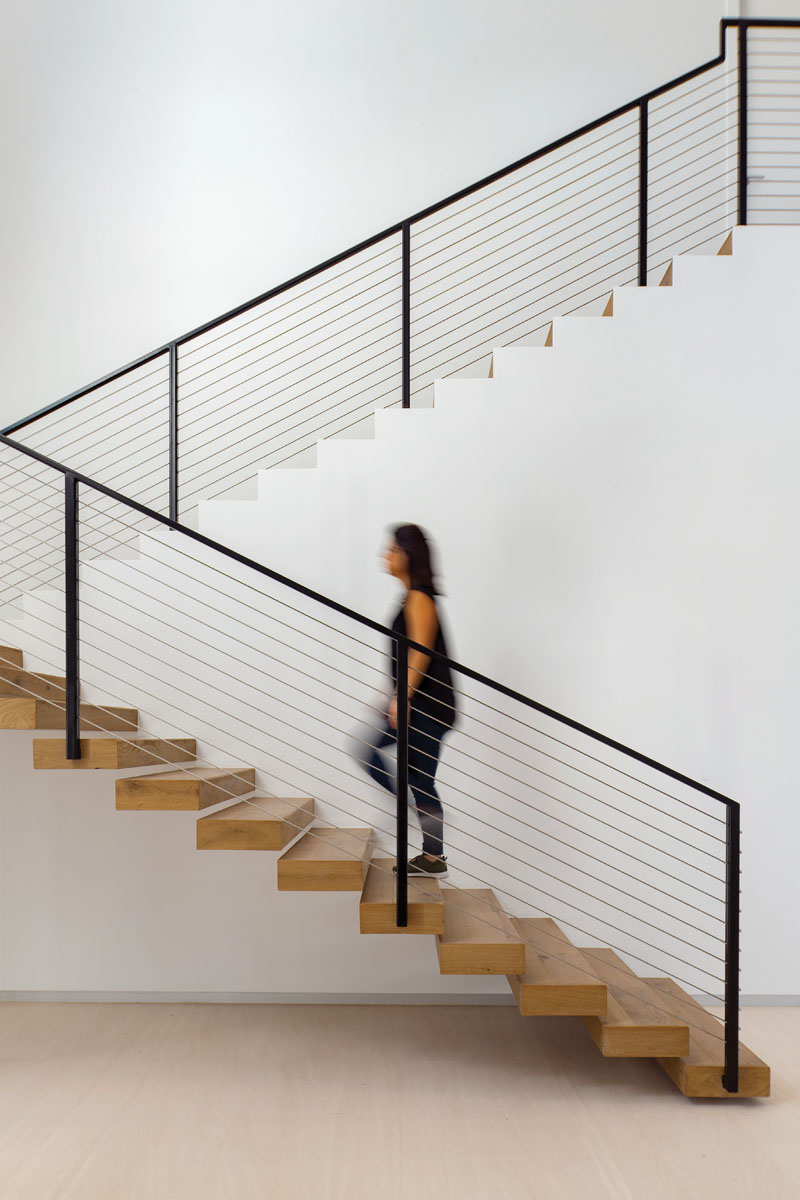 """""""The stairway is one of the home's most beautiful features,"""" architect and interior designer Stephanie Halfen says. """"It is incredibly delicate with such a sensual outline that it truly becomes a work of art."""""""