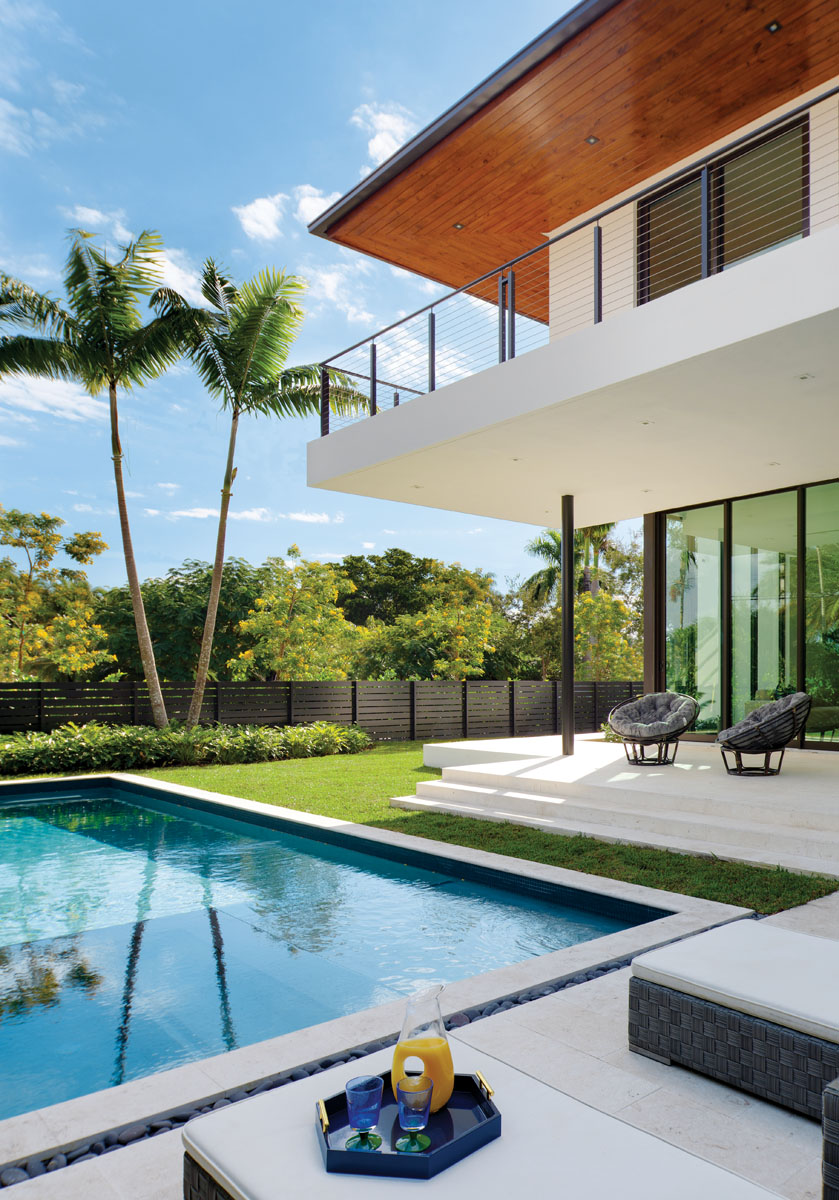 """""""Taking advantage of the home's location, the outdoor area offers a generous backyard, an inviting pool and spacious exterior living spaces,"""" architect and interior designer Stephanie Halfen says."""
