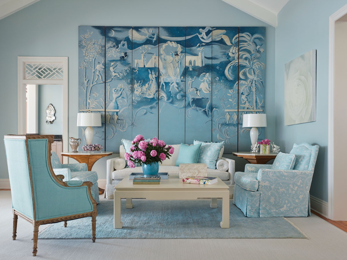 Inspiring the living room palette, China Seas' soft pattern from Quadrille wraps a pair of lounge chairs in cool comfort. An elegant find at Newel Antiques, the Jean-Denis Malclès screen.