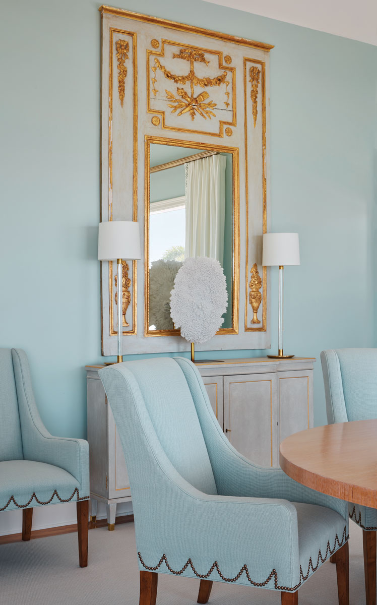 A gilded mirror and pedestal tables were plucked from the clients' inventory to nail the palette and anchor the dining room scheme.