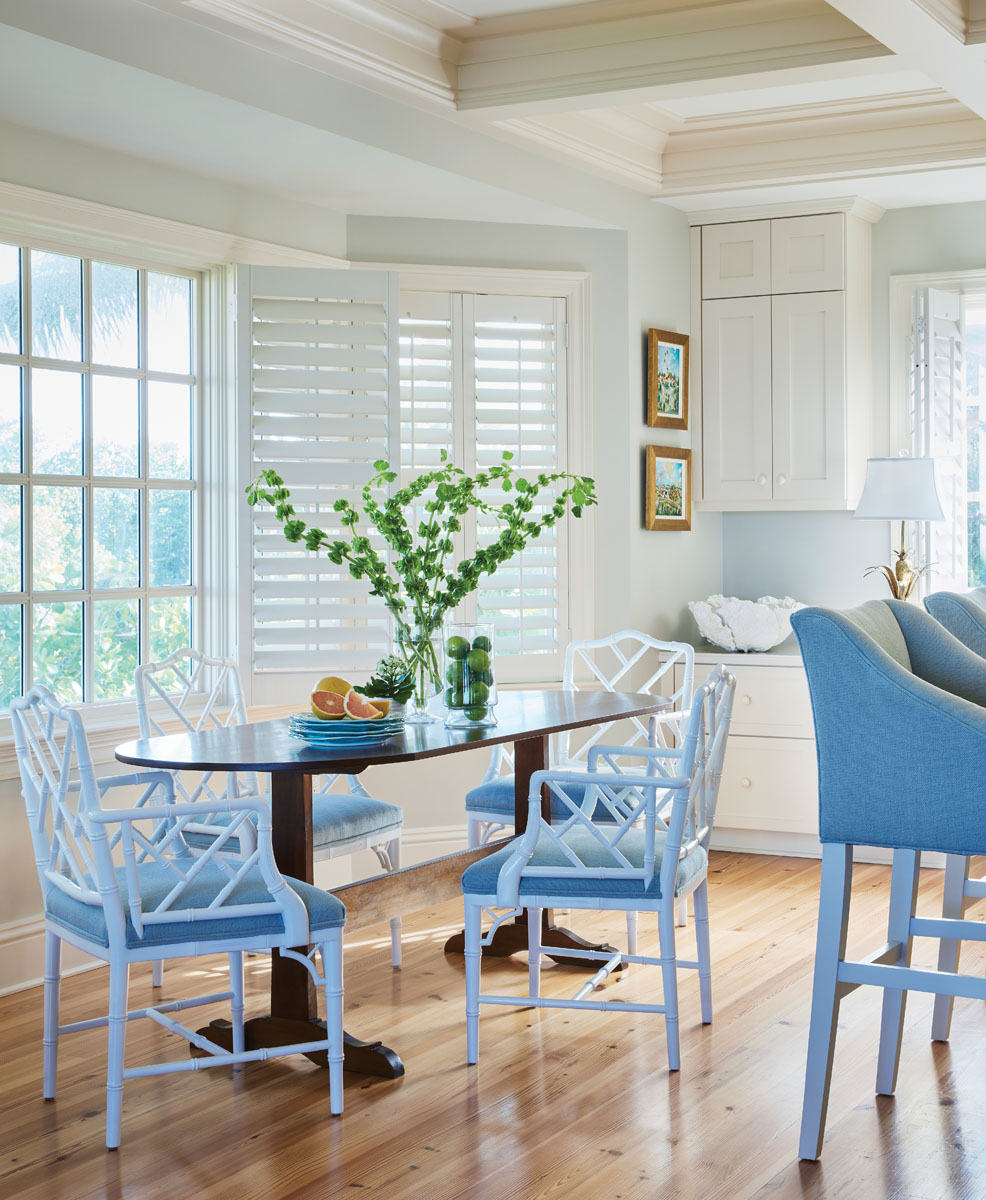 In the breakfast area, Chippendale chairs from TCS circle Robert Johnson Furniture's table to shape a cozy, casual dining space.